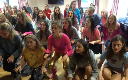 Practising the Unison for the House Singing Competition