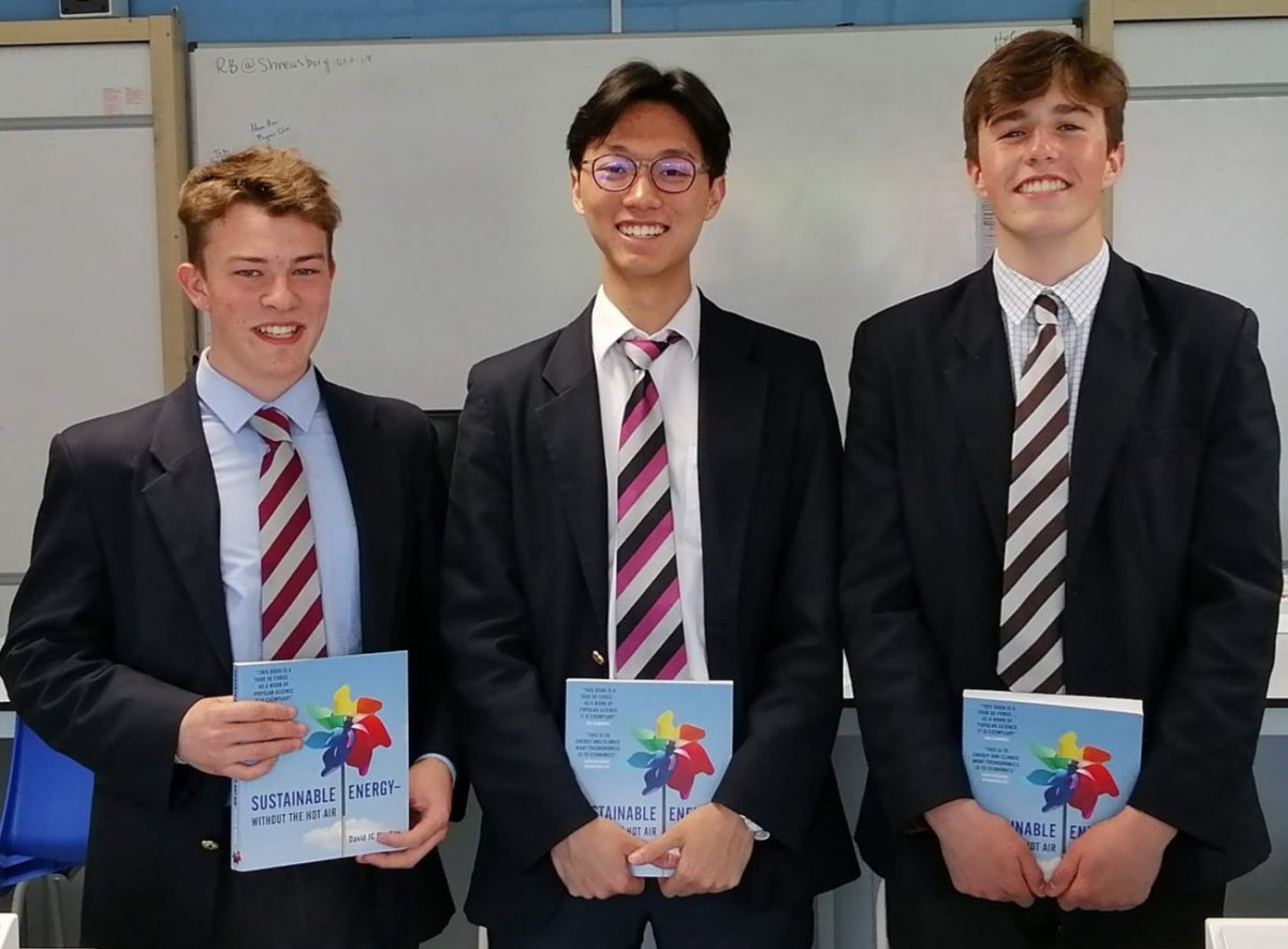 Billy Watkinson, Milton Tai and Joe Pattenden receive their award for their achievement of obtaining gold medals in the GCSE Physics Olympiad
