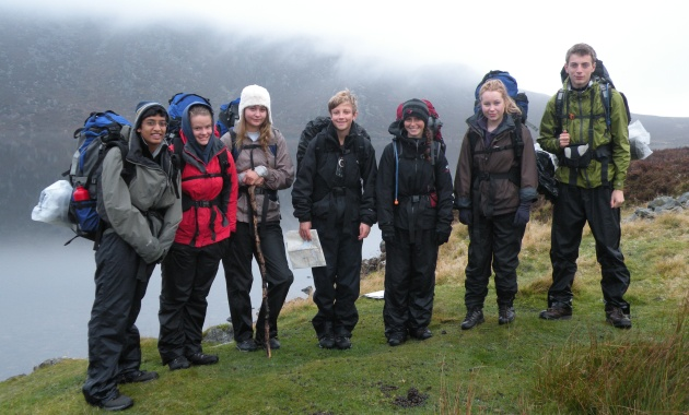 The group setting out from their wild camp in the Arenigs