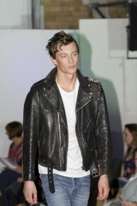 Matthew Barnett in a leather jacket designed by Hamish McAllister